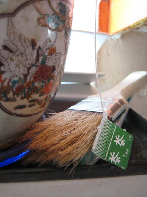 Still life with tea bag and basting brush